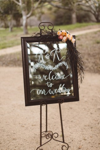styled shoot mirror on decorative easel