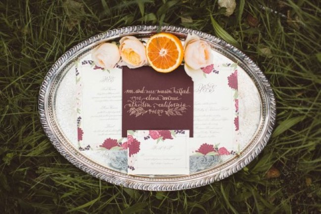 coming of fall styled shoot invitation set on silver platter in grass