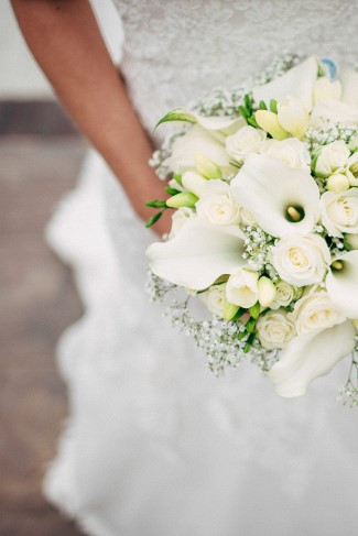 Bridal bouquet with ivory lilies, ivory roses, baby's breath and ivory hydrangeas