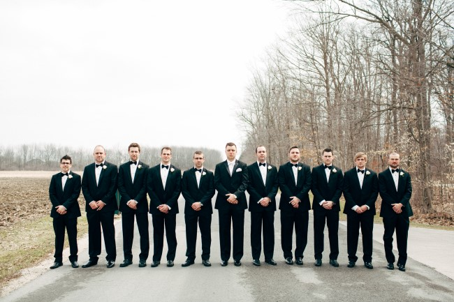 Groom with groomsmen wearing black tux with bow ties