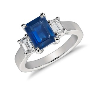 emerald cut sapphire enegagement ring with two side stones
