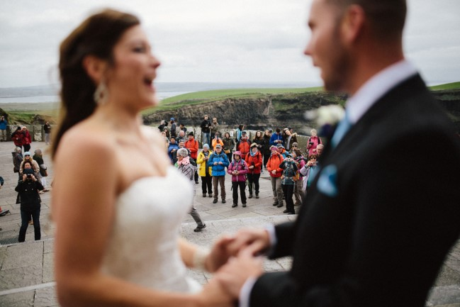 Cliffs of Moher wedding ceremony with crowd watching