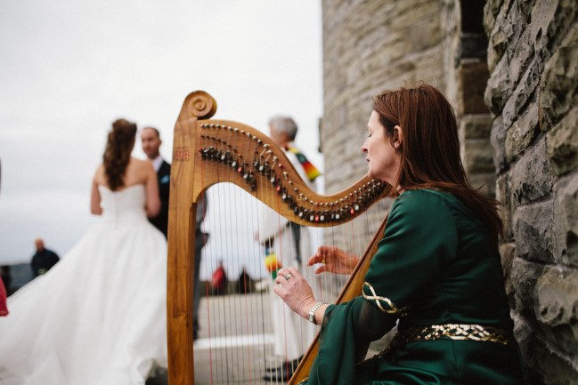Irish harpist playing harp at cliffs of moher wedding ceremony
