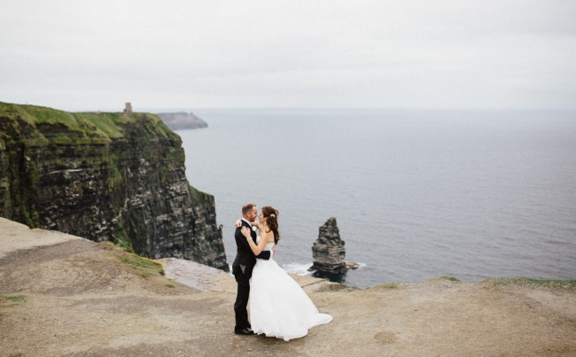Krista & Joseph standing at the Cliffs of Moher