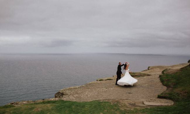 Bride and groom dancing on the cliffs of Moher captured by David Olsthoorn Photography