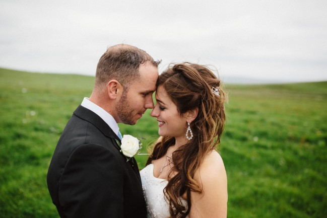 Bride and groom head to head on the cliffs of Moher. Brides hair done by Its U Hair Salon