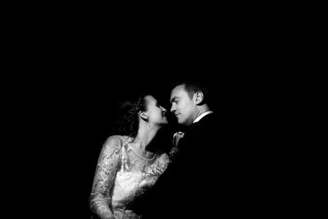 Black and white photo of a bride and groom looking at each other captured by Qualcosa di Blu - Wedding Photography