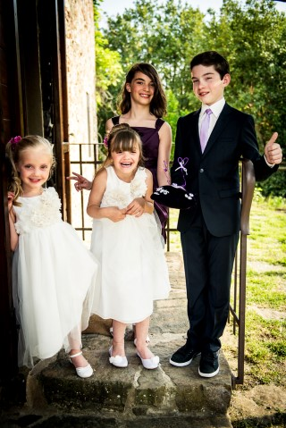 Flower girl and ring bearers ready for outdoor Tuscan wedding