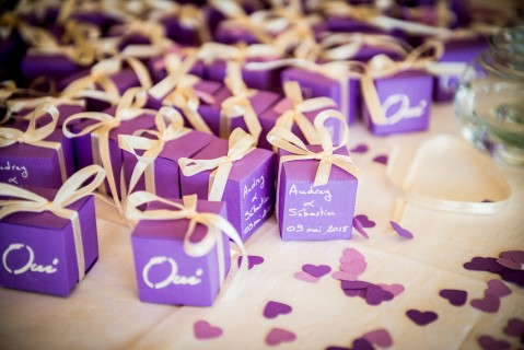 Purple wedding favor boxes with white bows