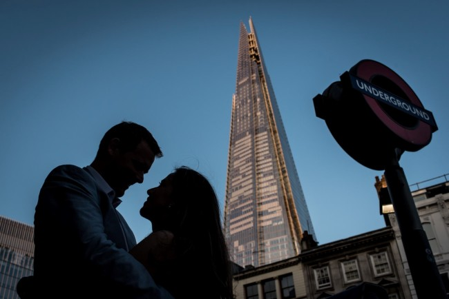 Engaged Couple embracing under the Shard in London