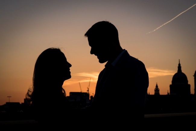 Engagement shoot at sunset with London sky line behind