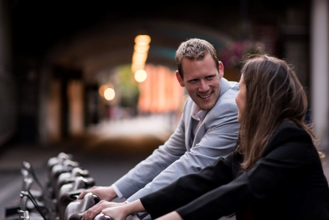 Engagement shoot in London England with couple riding Barclay bikes
