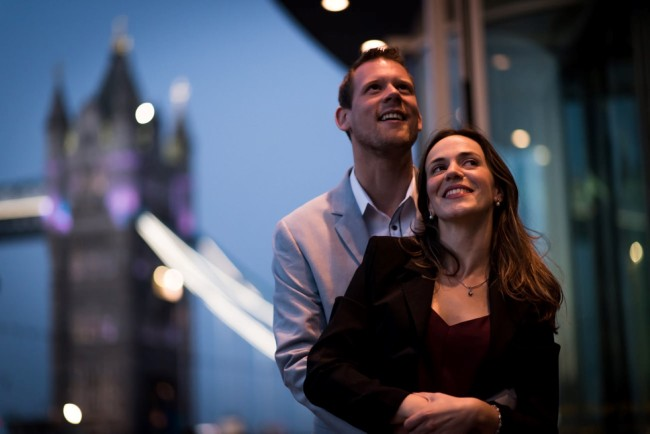 Couple embracing in front of Tower Bridge
