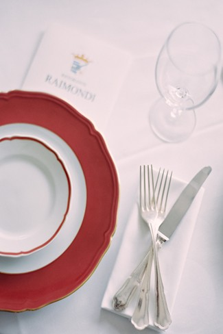 Red place setting at wedding reception in Villa Flori