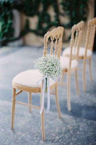 Outdoor Wedding ceremony chairs with baby's breath at Villa Del Balbianello