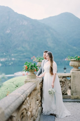 Bride and groom looking out over lake como