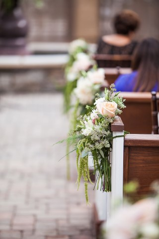 light pink roses and greenery as aisle markers
