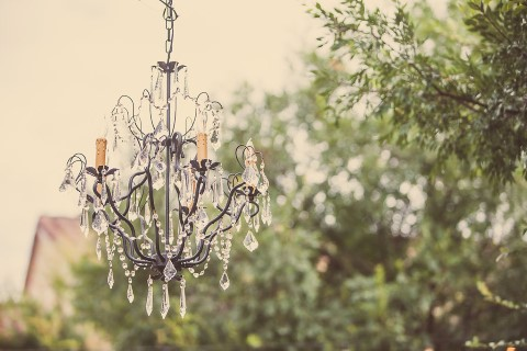 chandelier hanging outdoors for wedding ceremony