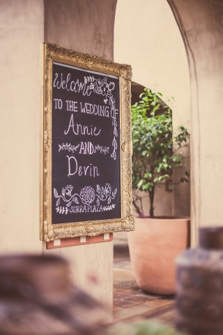gold framed chalkboard sign