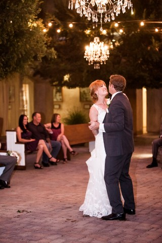 dancing outdoors under lit chandeliers