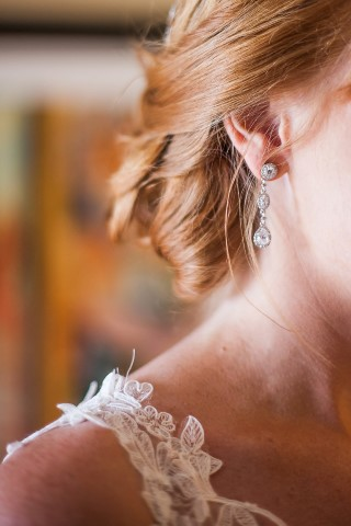 close up of bride's ear rings