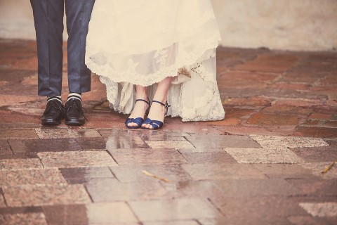 photo of brides and groom's legs and shoes