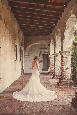 bride with long train at old brick foyer