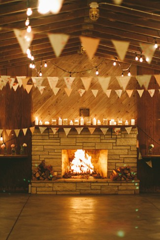 Bunting and an open fire for a rustic wedding reception