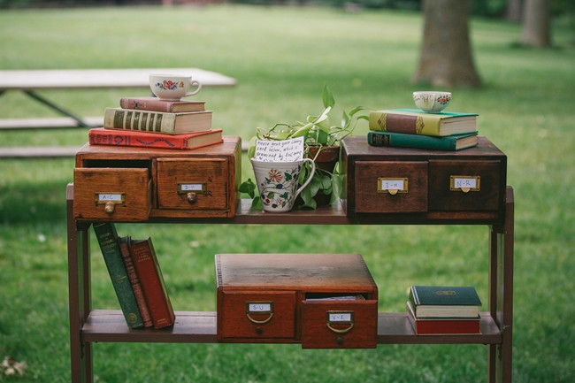 Vintage bookshelf with drawers and old books for outdoor wedding decor