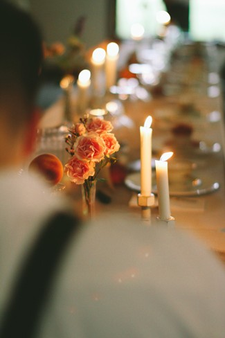 Long wedding reception table with candle sticks