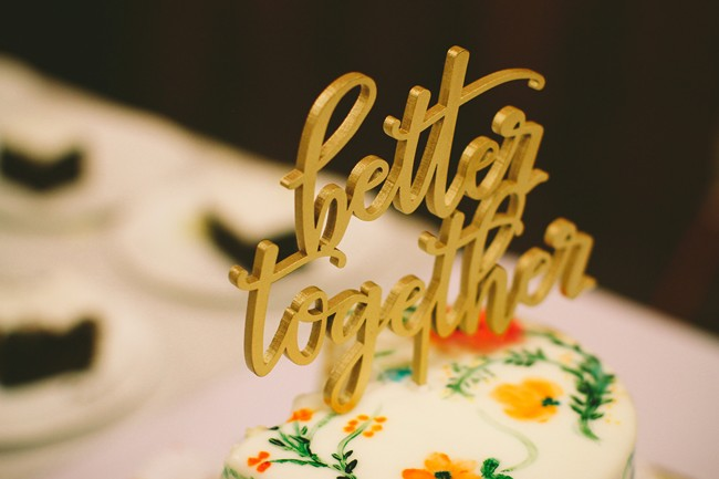 "1 tier wedding cake with gold cake topper spelling ""better together"""