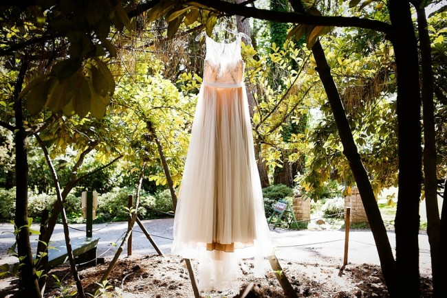 Wedding dress hanging in a forest from Dreamnette Bridal