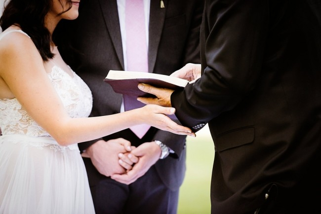 Bride and groom holding hands during wedding ceremony captured by Lauren Lindley Photography