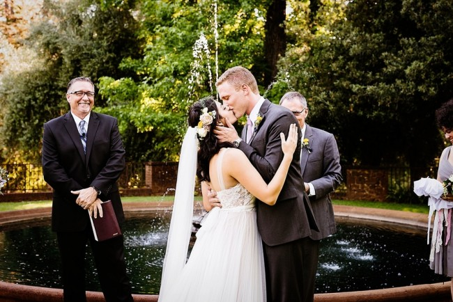 Bride and groom kissing during outdoor ceremony at Empire Mine State Park