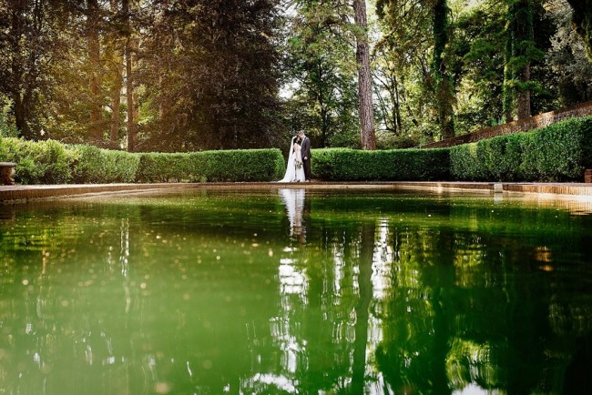 Lauren Lindley Photography captured bride in groom in front of a pond