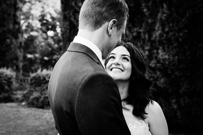 Black and white photo of bride and groom looking at each other captured by Lauren Lindley Photography
