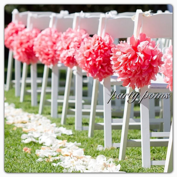 Pink pom poms for ceremony aisle decor