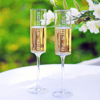 Champagne toasting glasses for the bride and groom