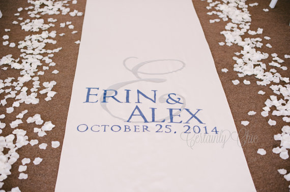 White aisle runner with bride and grooms names and wedding date