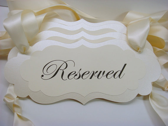 Cream reserved sign for wedding ceremony