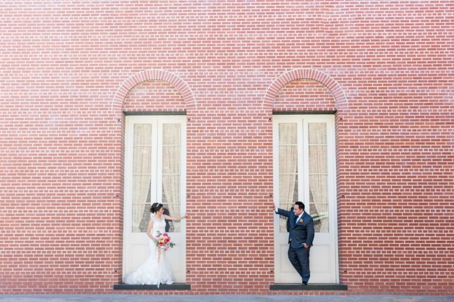 newlyweds in windowed brick