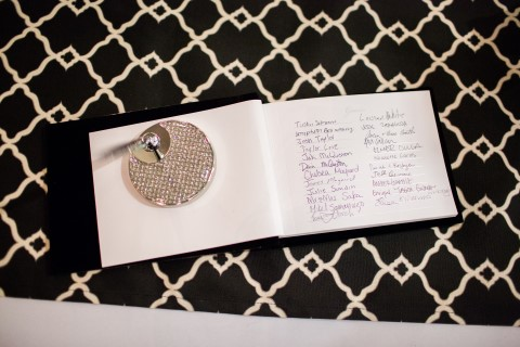 Guest book on black and white patterned table cloth