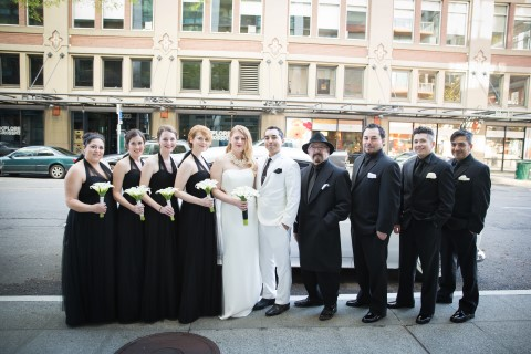 Bride and groom with bridal party all wearing black