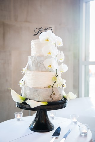 4 tier white and grey wedding cake created by Crème de la Crème in Seattle