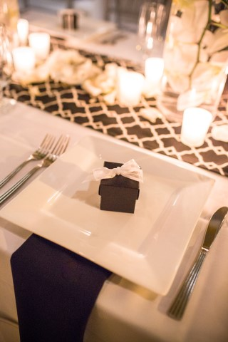 Black and white wedding reception table scape created by Manette Gracie Events