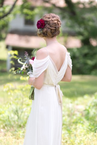 Bride wearing a swirly up-do created by  Main Street Hair Studio