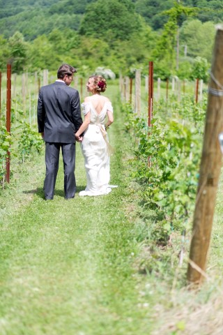 Couple walking along the vineyards of DuCard Vineyards