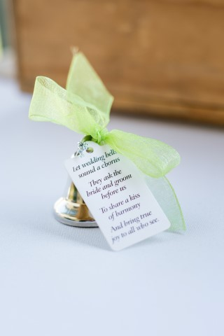 Silver bell with green ribbon for wedding guests
