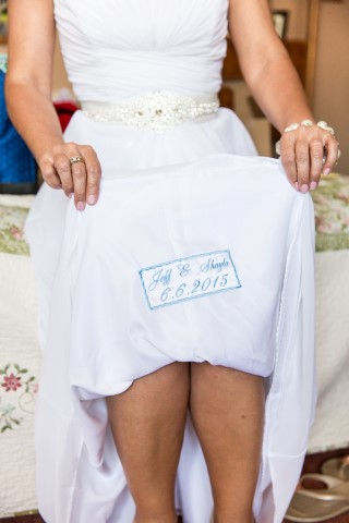 Bride showing underneath her Davids bridal gown and the blue embroidered wedding date