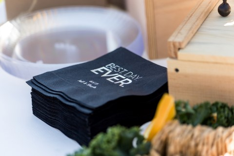 "Black napkins with ""Best Day Ever"" printed on them"